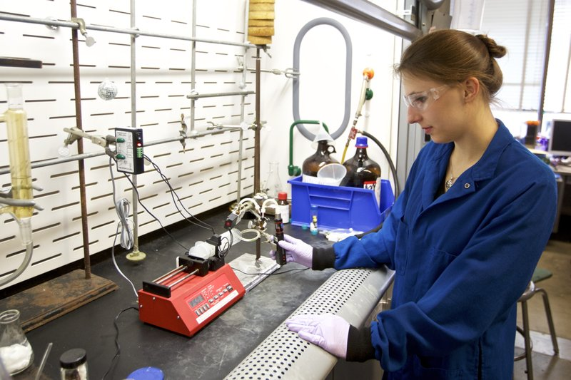 Graduate student Anna Duell uses a syringe pump to get accurate and reproducible puffs off an e-cigarette for aerosol collection in a lab at Portland State University in Portland, Ore. (AP Photo/Craig Mitchelldyer)
