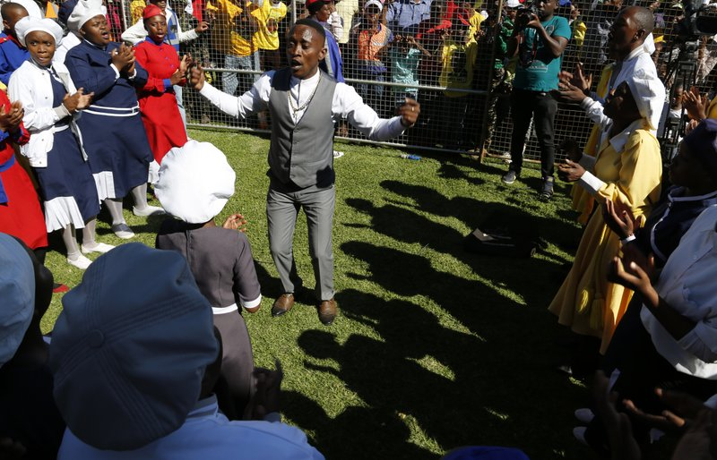 A gospel choir performs at Freedom Day celebrations in Kwa-Thema Township, near Johannesburg, Saturday April 27, 2019. (AP Photo/Denis Farrell)