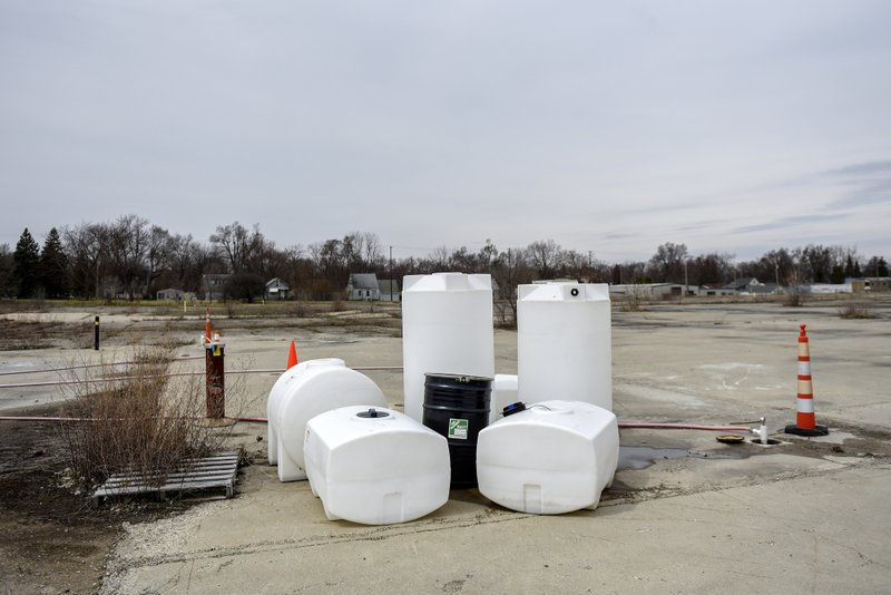 Empty containers that hold nontoxic fluids when crews need to use them while working are seen on Thursday, April 11, 2019, at the RACER Lansing Plant 2. (Nick King/Lansing State Journal via AP)