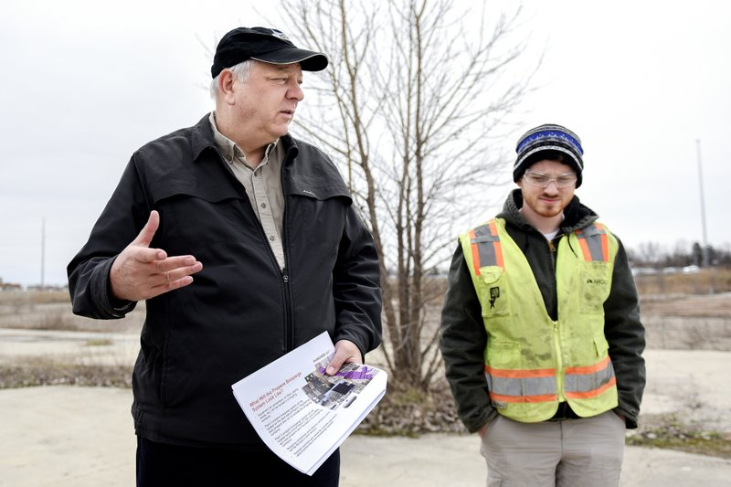 Dave Favero, deputy cleanup manager for the RACER sites, left, talks about the proposed 1,4 dioxane clean up on Thursday, April 11, 2019, at the RACER Lansing Plant 2. (Nick King/Lansing State Journal via AP)