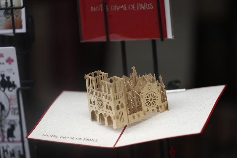 A replica of Notre Dame cathedral goes on sale in a souvenirs shop ,Tuesday, April 23, 2019 in Paris. (AP Photo/Thibault Camus)