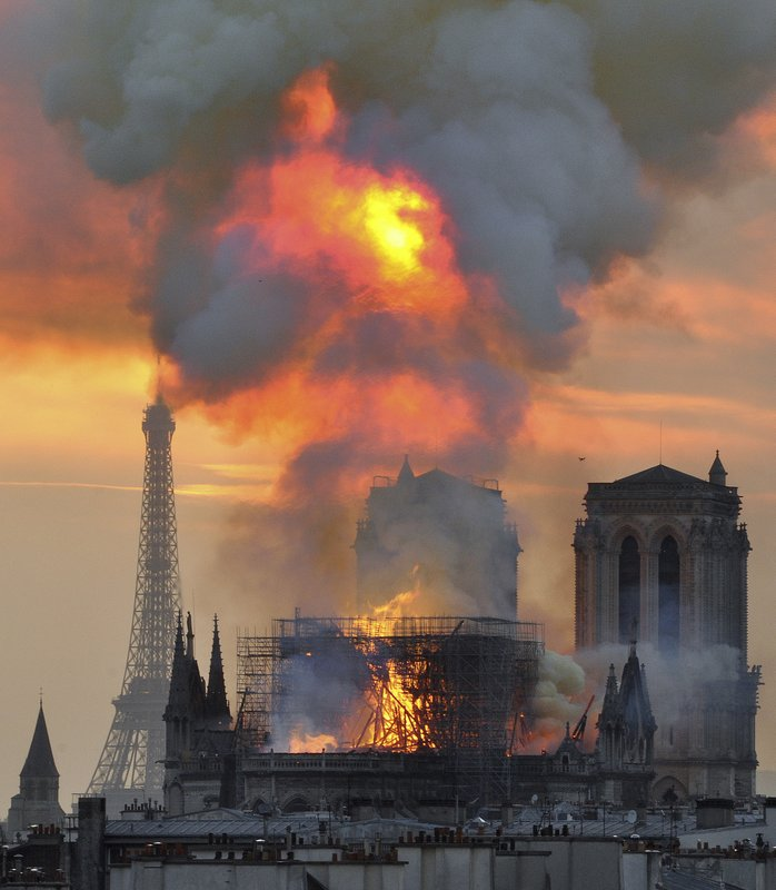 In this image made available on Tuesday April 16, 2019 flames and smoke rise from the blaze at Notre Dame cathedral in Paris, Monday, April 15, 2019. (AP Photo/Thierry Mallet)