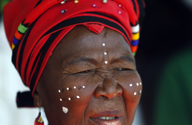 A woman attends Freedom Day celebrations in Kwa-Thema Township, near Johannesburg, Saturday April 27, 2019. (AP Photo/Denis Farrell)