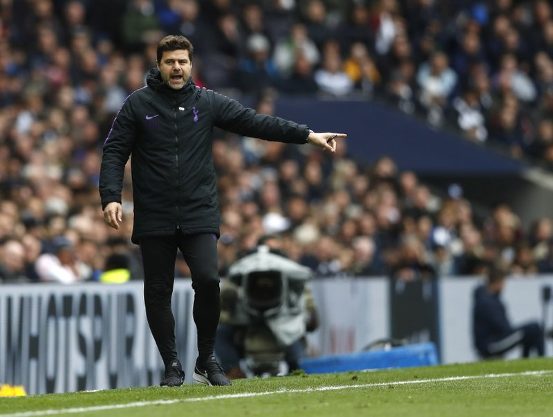 Tottenham Hotspur's manager Mauricio Pochettino gives directions to the players during the English Premier League soccer match between Tottenham Hotspur and West Ham United at White Hart Lane in London, Saturday, April, 27, 2019. (AP Photo/Alastair Grant)