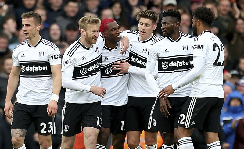 Fulham's Ryan Babel, center left, celebrates scoring his side's first goal of the game during the English Premier League soccer match between Fulham and Cardiff City at Craven Cottage stadium, London, England. (Steven Paston/PA via AP)