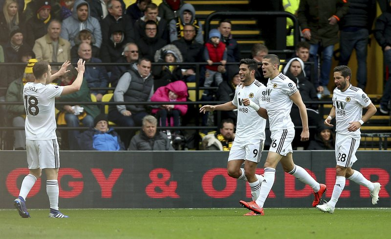 Wolverhampton Wanderers' Raul Jimenez, third right, celebrates scoring his side's first goal of the game during their English Premier League soccer match against Watford at Vicarage Road, Watford, England, Saturday, April 27, 2019. (Nigel French/PA via AP)