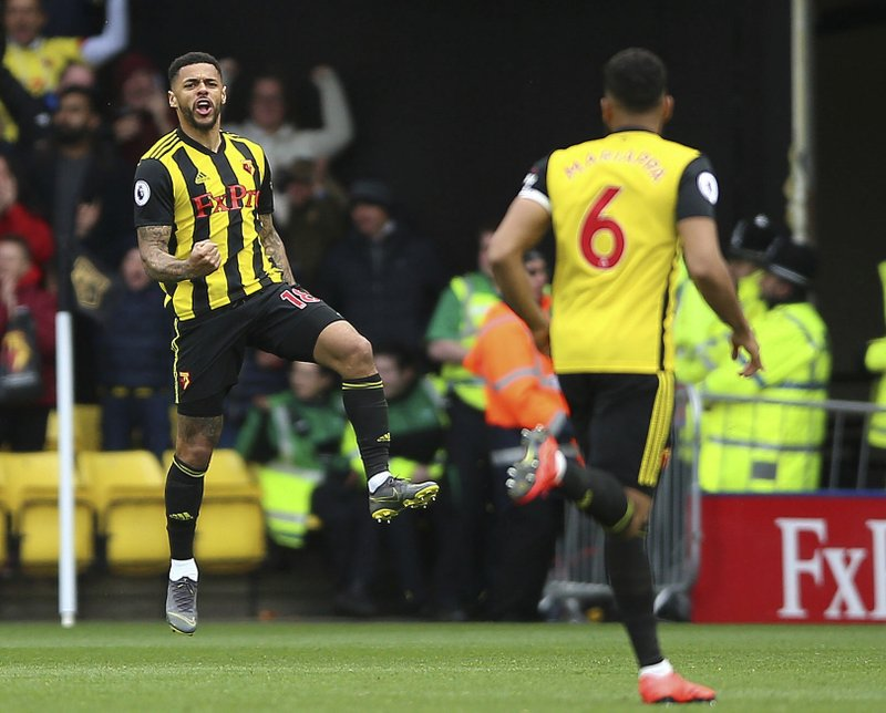 Watford's Andre Gray celebrates scoring his side's first goal of the game during the English Premier League soccer match between Watford and Wolverhampton Wanderers at the Vicarage Road stadium, Watford, England. (Nigel French/PA via AP)