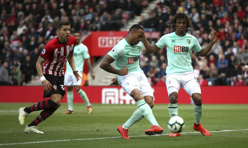 Bournemouth's Callum Wilson, center, scores his side's second goal of the game during their English Premier League soccer match against Southampton at St Mary's Stadium, Southampton, England, Saturday, April 27, 2019. (Adam Davy/PA via AP)