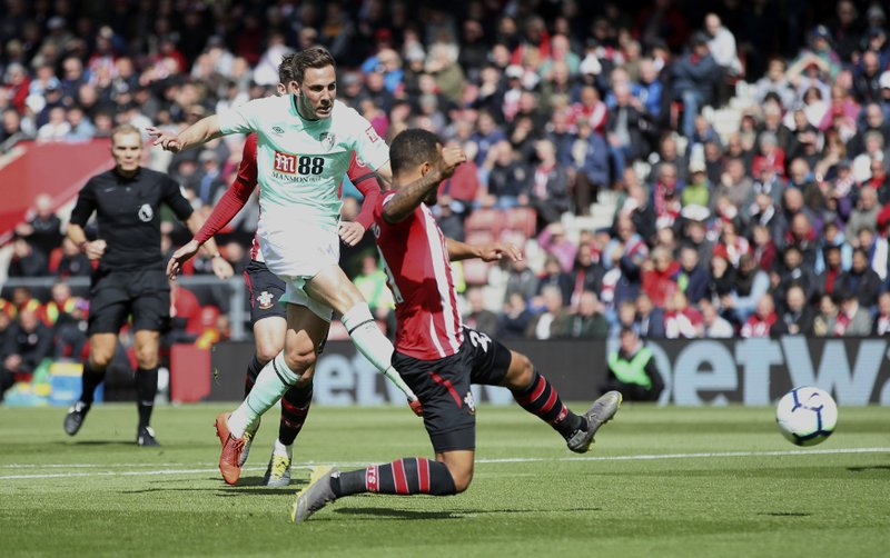 Bournemouth's Dan Gosling scores his side's first goal of the game during their English Premier League soccer match against Southampton at St Mary's Stadium, Southampton, England, Saturday, April 27, 2019. (Adam Davy/PA via AP)