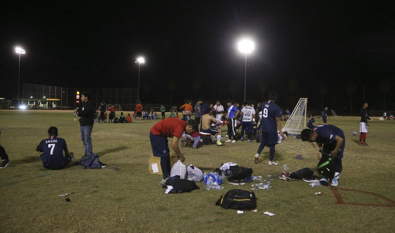 Players pack up after a Maya Chapin soccer league game Wednesday, April 17, 2019, in Phoenix. (AP Photo/Ross D. Franklin)