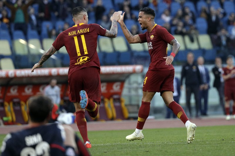 Roma's Aleksandar Kolarov , left, celebrates with his teammate Justin Kluivert after he scored his side's third goal during a Serie A soccer match between Roma and Cagliari, at Rome's Olympic Stadium, Saturday, April 27, 2019. (AP Photo/Gregorio Borgia)