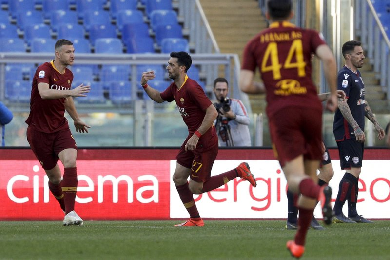 Roma's Javier Pastore, center, celebrates after he scored his side's second goal during a Serie A soccer match between Roma and Cagliari, at Rome's Olympic Stadium, Saturday, April 27, 2019. (AP Photo/Gregorio Borgia)