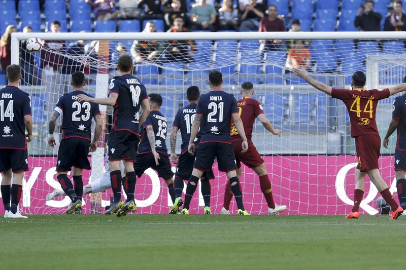 Roma's Federico Fazio scores his side's first goal during a Serie A soccer match between Roma and Cagliari, at Rome's Olympic Stadium, Saturday, April 27, 2019. (AP Photo/Gregorio Borgia)