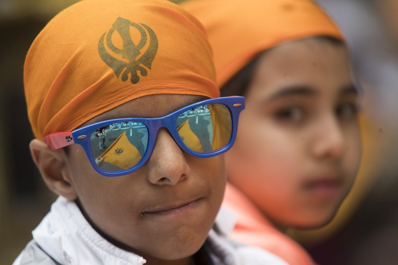 Participants wear headbands with the image of the Khanda, the symbol of the Sikh faith, during the Sikh Day Parade, celebrating the Sikh holiday of Vaisakhi, Saturday, April 27, 2019, in New York. (AP Photo/Mary Altaffer)