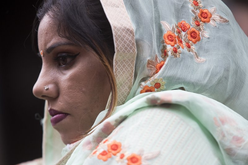 A Sikh woman watches as participants march down Madison Avenue during the Sikh Day Parade, celebrating the Sikh holiday of Vaisakhi, Saturday, April 27, 2019, in New York. (AP Photo/Mary Altaffer)