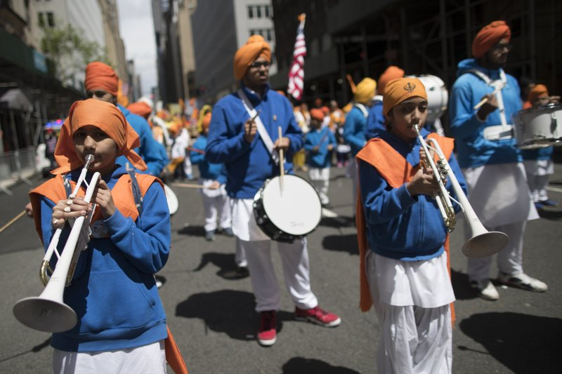 Participants march down Madison Avenue during the Sikh Day Parade, celebrating the Sikh holiday of Vaisakhi, Saturday, April 27, 2019, in New York. (AP Photo/Mary Altaffer)
