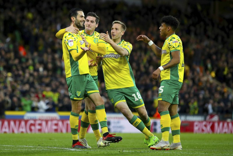 Norwich City's Mario Vrancic, left, celebrates scoring his side's second goal of the game during the English Championship soccer match at Carrow Road, Norwich, England, Saturday April 27, 2019. (Chris Radburn/PA via AP)