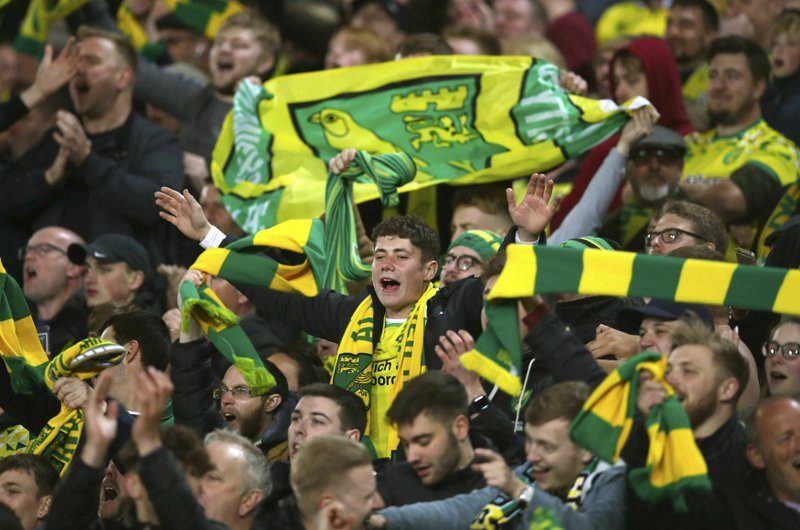 Norwich City fans celebrate after the English Championship soccer match against Blackburn Rovers at Carrow Road, Norwich, England, Saturday April 27, 2019. (Chris Radburn/PA via AP)