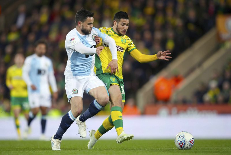 Blackburn Rovers' Craig Conway, left, and Norwich City's Emi Buendia battle for the ball  during the English Championship soccer match at Carrow Road, Norwich, England, Saturday April 27, 2019. (Chris Radburn/PA via AP)
