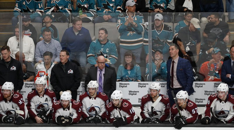 Colorado Avalanche head coach Jared Bednar, right, stands in the bench area in the third period against the San Jose Sharks in Game 1 of an NHL hockey second-round playoff series at the SAP Center in San Jose, Calif. (AP Photo/Josie Lepe)