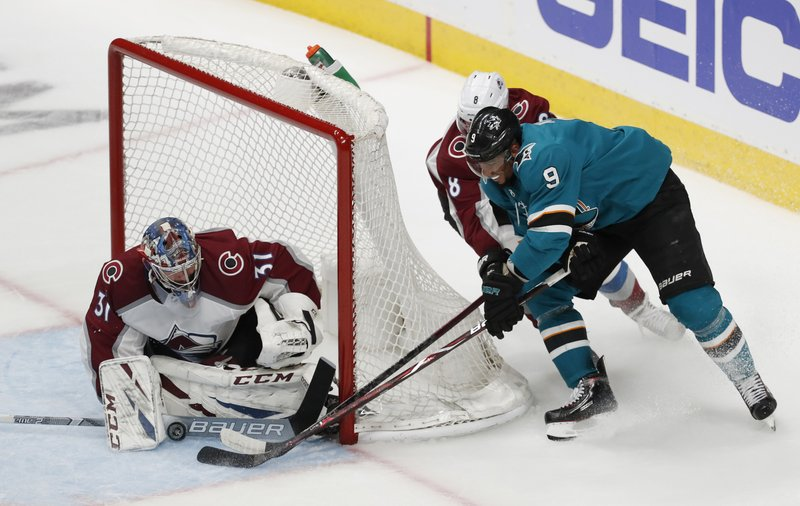 Colorado Avalanche goaltender Philipp Grubauer (31) makes a save against the San Jose Sharks' Evander Kane (9) in the third period of Game 1 of an NHL hockey second-round playoff series at the SAP Center in San Jose, Calif. (AP Photo/Josie Lepe)