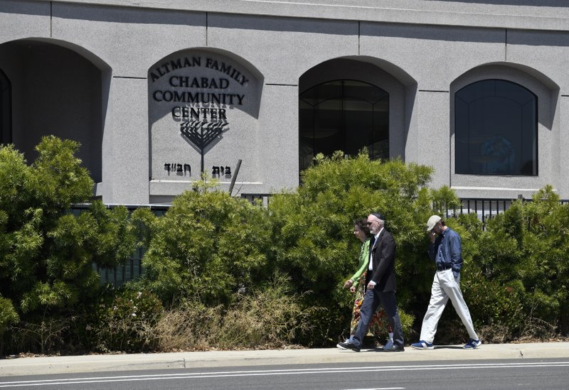Synagogue members walk outside of the Chabad of Poway Synagogue Saturday, April 27, 2019, in Poway, Calif. (AP Photo/Denis Poroy)