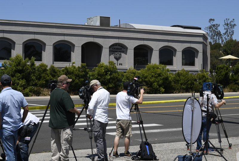 Television cameras film the outside of the Chabad of Poway Synagogue Saturday, April 27, 2019, in Poway, Calif. (AP Photo/Denis Poroy)