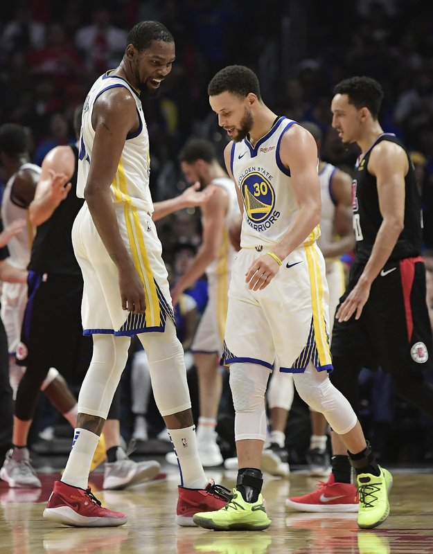 Golden State Warriors guard Stephen Curry, left, talks with guard Stephen Curry during the second half in Game 6 of a first-round NBA basketball playoff series against the Los Angeles Clippers Friday, April 26, 2019, in Los Angeles. (AP Photo/Mark J. Terrill)