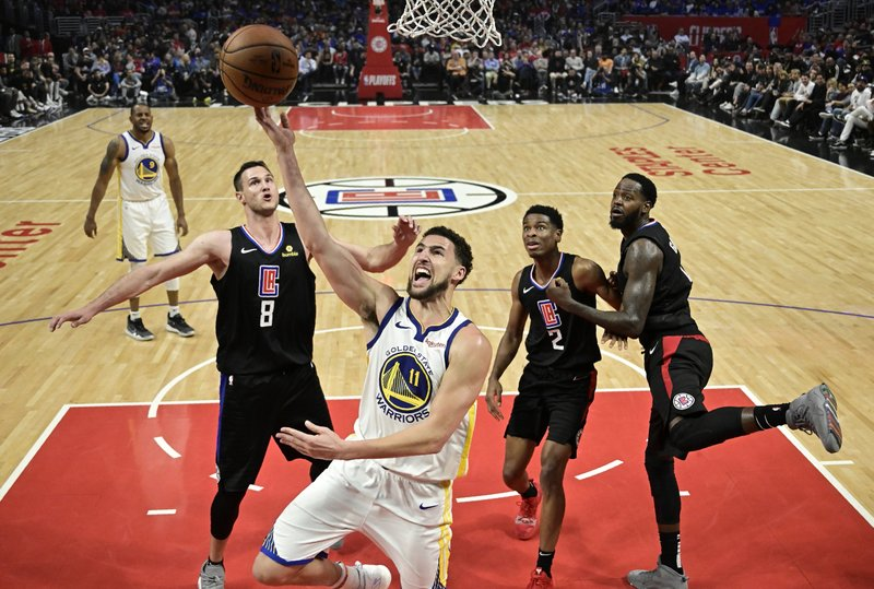 Golden State Warriors guard Klay Thompson, center, as Los Angeles Clippers forward Danilo Gallinari, second from left, guard Shai Gilgeous-Alexander, second from right, and forward JaMychal Green defend during the second half in Game 6 of a first-round NBA basketball playoff series Friday, April 26, 2019, in Los Angeles. (AP Photo/Mark J. Terrill)
