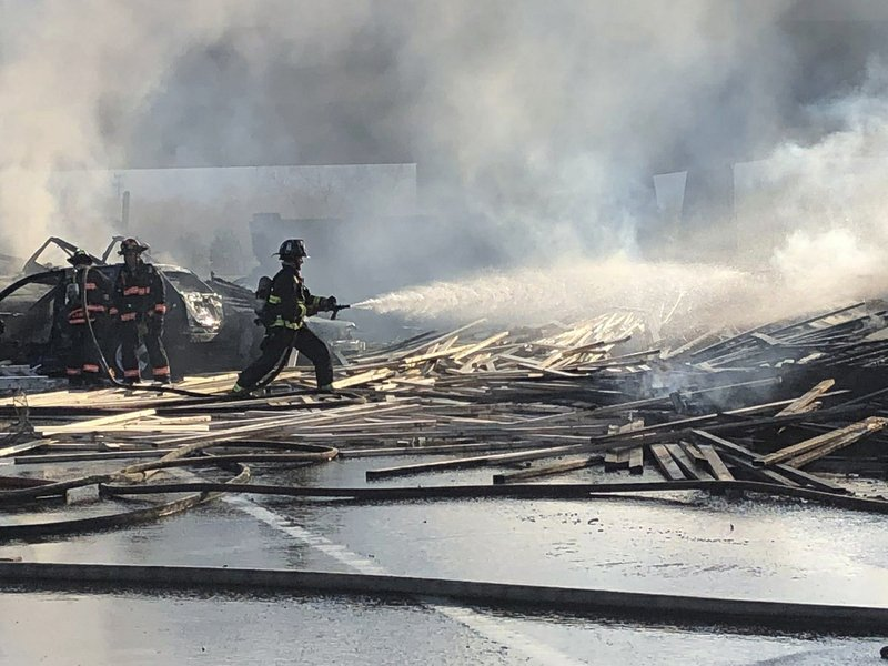 This Thursday, April 25, 2019 photo provided by West Metro Fire Rescue shows a fire fighter working the scene of a deadly pileup involving over two dozen vehicles near Denver. (Ronda Scholting/West Metro Fire Rescue via AP)