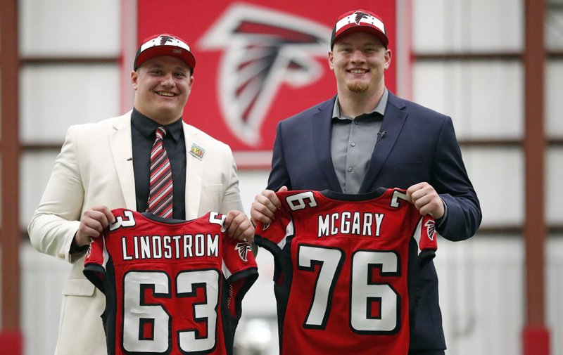 Atlanta Falcons NFL football first-round-draft picks Chris Lindstrom, left, of Boston College, and Kaleb McGary, from Washington, pose with their jerseys for a photo Friday, April 26, 2019, in Flowery Branch, Ga. (AP Photo/John Bazemore)