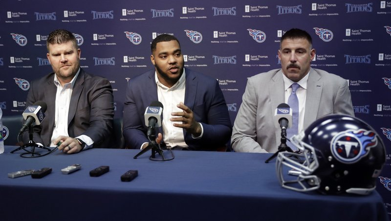 Mississippi State defensive tackle Jeffery Simmons, center, attends a news conference with Tennessee Titans general manager Jon Robinson, left, and head coach Mike Vrabel during a news conference Friday, April 26, 2019, in Nashville, Tenn. (AP Photo/Mark Humphrey)