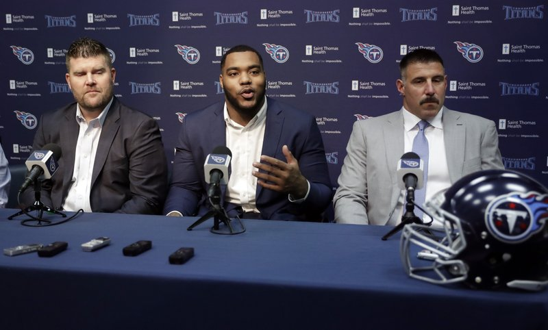 Mississippi State defensive tackle Jeffery Simmons, center, speaks at a news conference with Tennessee Titans general manager Jon Robinson, left, and head coach Mike Vrabel, right, Friday, April 26, 2019, in Nashville, Tenn. (AP Photo/Mark Humphrey)