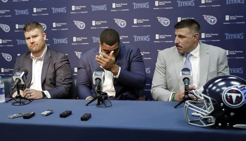 Mississippi State defensive tackle Jeffery Simmons, center, wipes tears as he appears at a news conference with Tennessee Titans general manager Jon Robinson, left, and head coach Mike Vrabel, right, Friday, April 26, 2019, in Nashville, Tenn. (AP Photo/Mark Humphrey)
