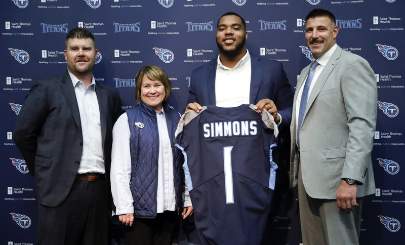 Mississippi State defensive tackle Jeffery Simmons, second from right, poses with Tennessee Titans general manager Jon Robinson, left, owner Amy Adams Strunk, second from left; and head coach Mike Vrabel, right; during an NFL football news conference Friday, April 26, 2019, in Nashville, Tenn. (AP Photo/Mark Humphrey)
