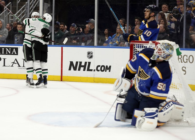 Dallas Stars' Mattias Janmark (13), of Sweden, is congratulated by teammate Jason Dickinson, left, after scoring past St. (50) during the first period in Game 2 of an NHL second-round hockey playoff series Saturday, April 27, 2019, in St. Louis. (AP Photo/Jeff Roberson)