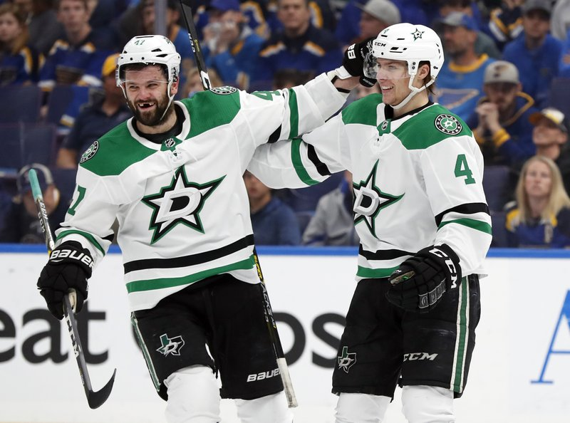 Dallas Stars' Miro Heiskanen (4), of Finland, is congratulated by Alexander Radulov after scoring during the first period in Game 2 of an NHL second-round hockey playoff series against the St. (AP Photo/Jeff Roberson)