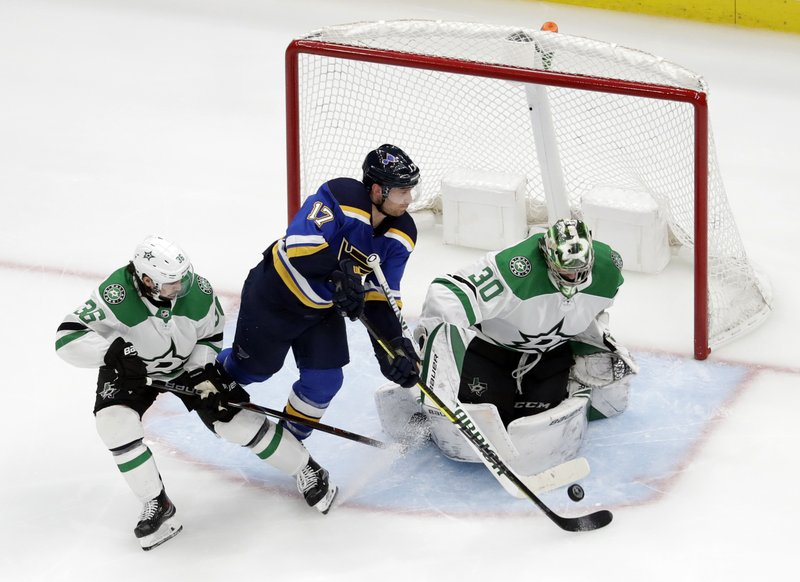 St. Louis Blues' Jaden Schwartz (17) scores past Dallas Stars goaltender Ben Bishop (30) and Mats Zuccarello (36) during the third period in Game 2 of an NHL second-round hockey playoff series Saturday, April 27, 2019, in St. (AP Photo/Jeff Roberson)