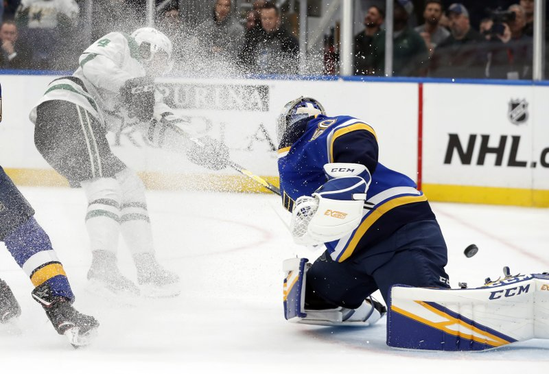 Dallas Stars' Miro Heiskanen, of Finland, scores past St. Louis Blues goaltender Jordan Binnington during the first period in Game 2 of an NHL second-round hockey playoff series Saturday, April 27, 2019, in St. (AP Photo/Jeff Roberson)
