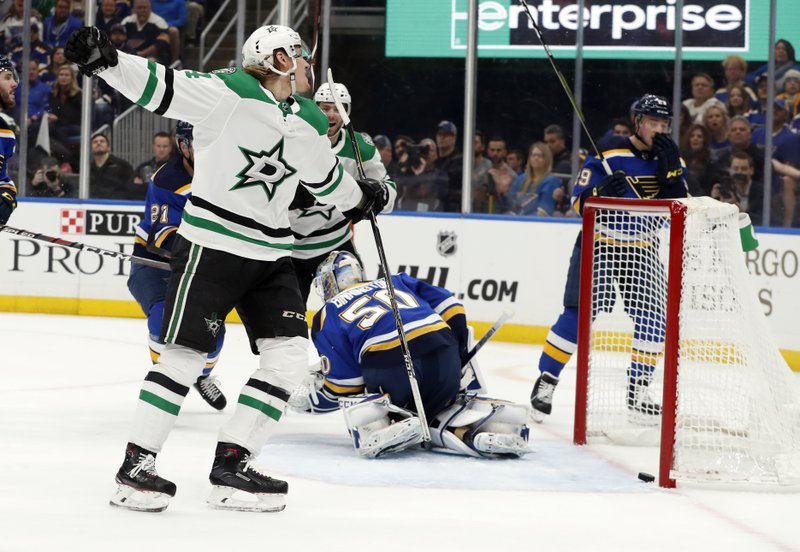 Dallas Stars' Roope Hintz, of Finland, left, celebrates after scoring past St. Louis Blues goaltender Jordan Binnington (50) during the first period in Game 2 of an NHL second-round hockey playoff series Saturday, April 27, 2019, in St. (AP Photo/Jeff Roberson)