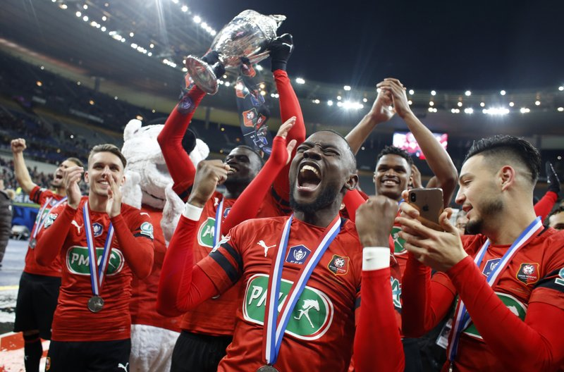 Players of Rennes celebrate with trophy after winning the French Cup soccer final between Rennes and Paris Saint Germain at the Stade de France stadium in Saint-Denis, outside Paris, France, Saturday, April 27, 2019. (AP Photo/Thibault Camus)