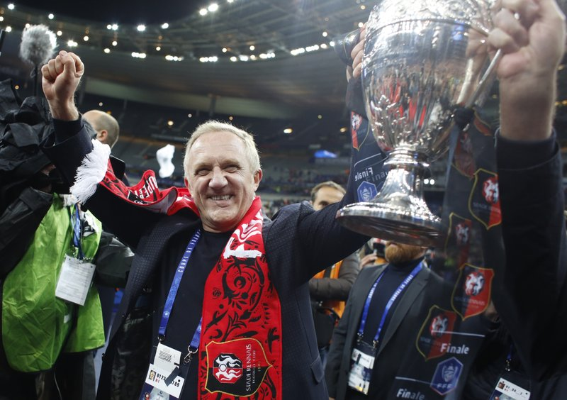 Owner of Rennes Francois-Henri Pinault celebrates with trophy after winning the French Cup soccer final between Rennes and Paris Saint Germain at the Stade de France stadium in Saint-Denis, outside Paris, France, Saturday, April 27, 2019. (AP Photo/Thibault Camus)