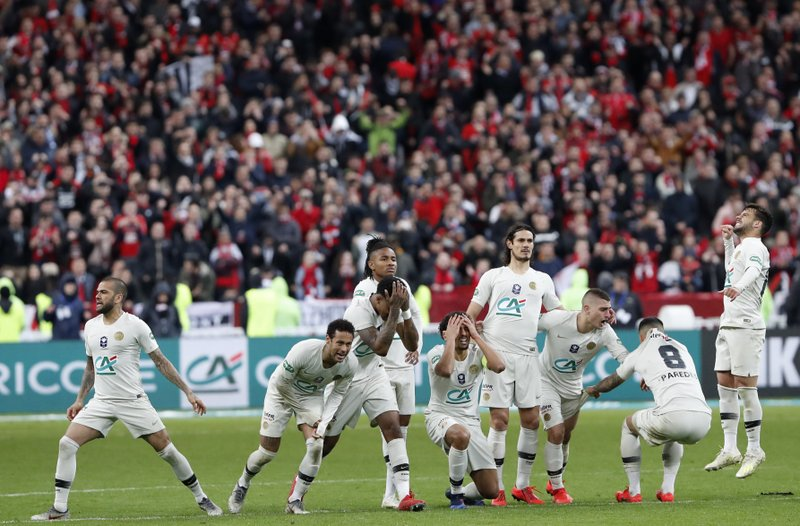 Players of PSG react during the penalty shootout during the French Cup soccer final between Rennes and Paris Saint Germain at the Stade de France stadium in Saint-Denis, outside Paris, France, Saturday, April 27, 2019. (AP Photo/Thibault Camus)