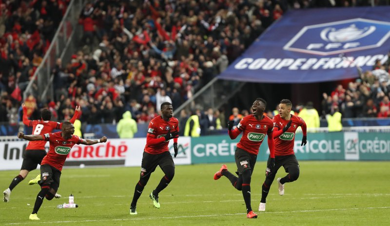 Players of Rennes run to celebrate after winning the French Cup soccer final between Rennes and Paris Saint Germain at the Stade de France stadium in Saint-Denis, outside Paris, France, Saturday, April 27, 2019. (AP Photo/Thibault Camus)