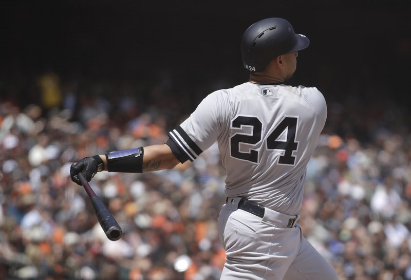 New York Yankees' Gary Sanchez swings for a grand slam off San Francisco Giants' Derek Holland in the fifth inning of a baseball game Saturday, April 27, 2019, in San Francisco. (AP Photo/Ben Margot)