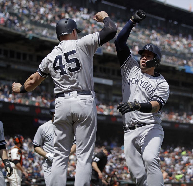 New York Yankees' Gary Sanchez, right, celebrates with Luke Voit (45) after hitting a grand slam off San Francisco Giants' Derek Holland in the fifth inning of a baseball game Saturday, April 27, 2019, in San Francisco. (AP Photo/Ben Margot)