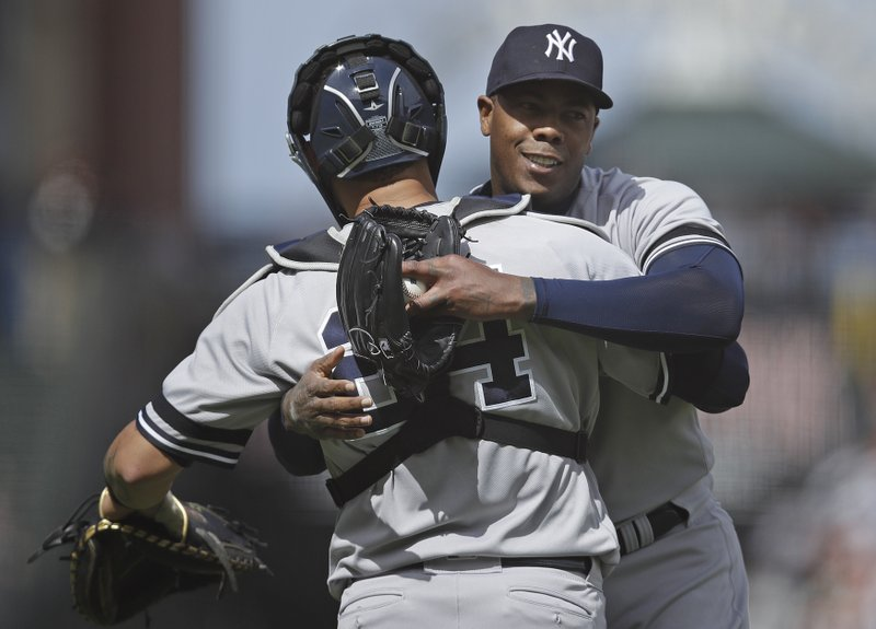 New York Yankees pitcher Aroldis Chapman, right, celebrates the 6-4 win over the San Francisco Giants with catcher Gary Sanchez (24) at the end of a baseball game Saturday, April 27, 2019, in San Francisco. (AP Photo/Ben Margot)