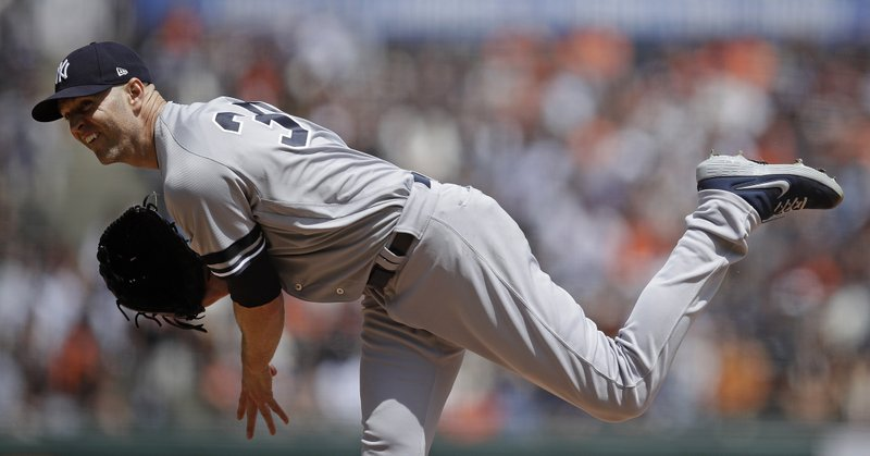 New York Yankees pitcher J.A. Happ works against the San Francisco Giants in the first inning of a baseball game Saturday, April 27, 2019, in San Francisco. (AP Photo/Ben Margot)