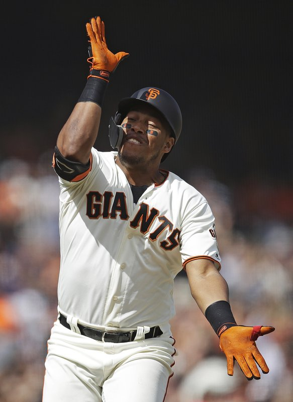 San Francisco Giants' Yangervis Solarte celebrates after hitting a three-run home run against the New York Yankees in the ninth inning of a baseball game, Saturday, April 27, 2019, in San Francisco. (AP Photo/Ben Margot)