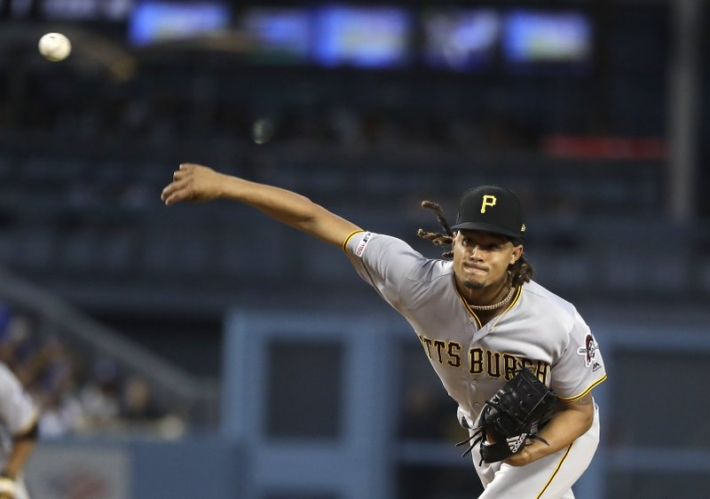 Pittsburgh Pirates starting pitcher Chris Archer throws to the Los Angeles Dodgers during the second inning of a baseball game Friday, April 26, 2019, in Los Angeles. (AP Photo/Marcio Jose Sanchez)